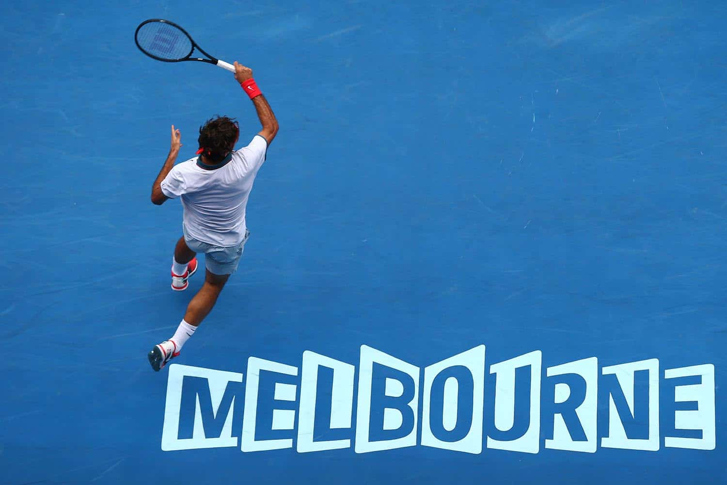 MELBOURNE, AUSTRALIA - JANUARY 18: Roger Federer of Switzerland plays a forehand in his third round match against Teymuraz Gabashvili of Russia during day six of the 2014 Australian Open at Melbourne Park on January 18, 2014 in Melbourne, Australia. (Photo by Ryan Pierse/Getty Images)